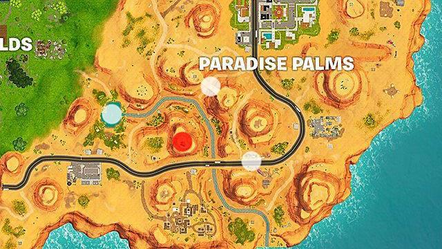 cerca tra un'oasi, un'arcata di pietra e dei dinosauri